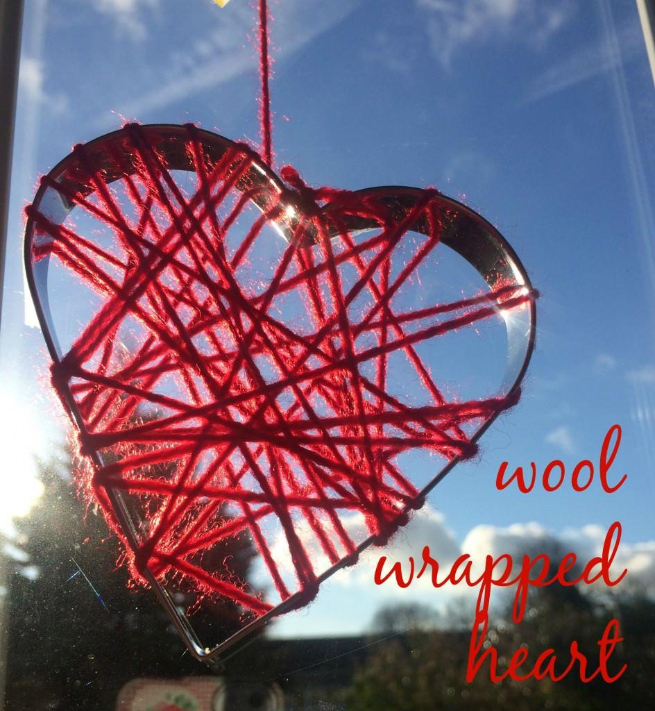 red wool wrapped heart in window