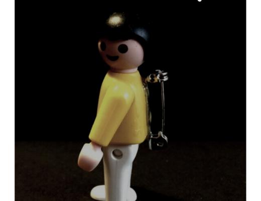 Vintage Playmobil figure badge