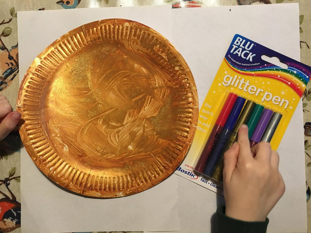 Gingerbread man paper plate with glitter pens