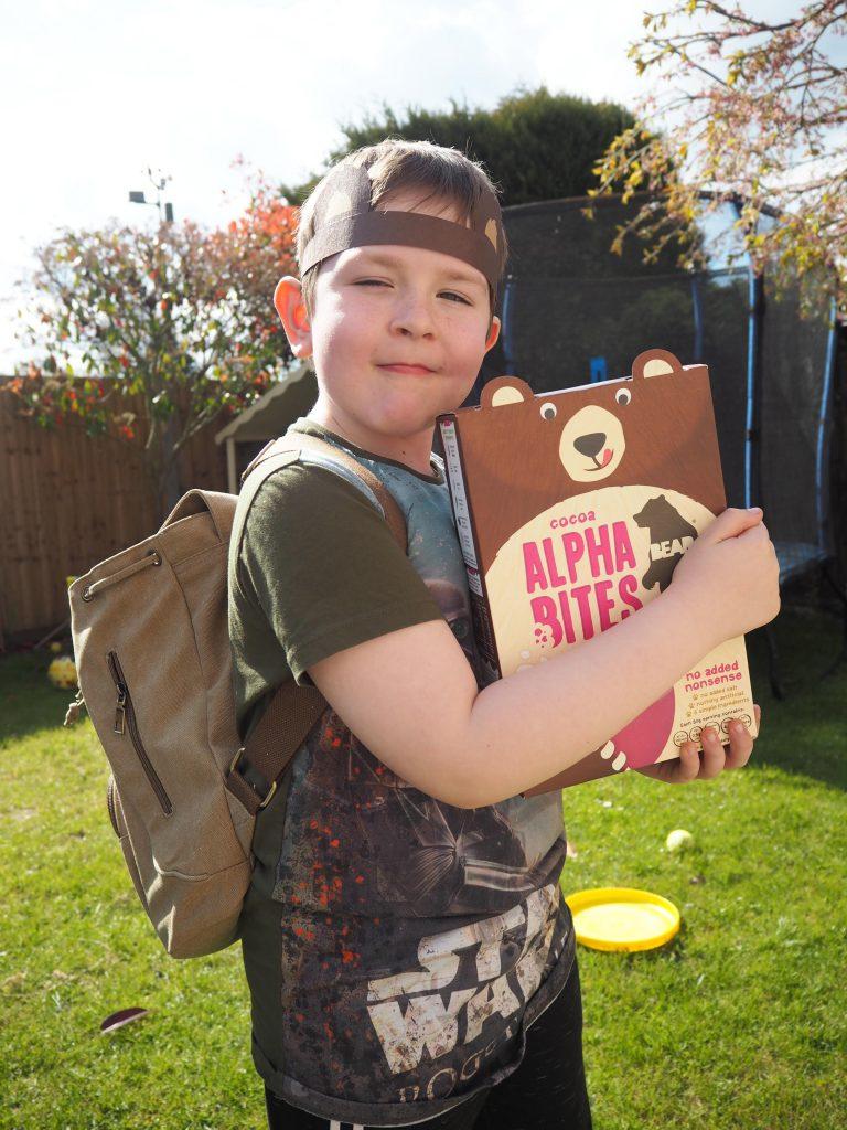 Boy with box of BEAR Alphabites