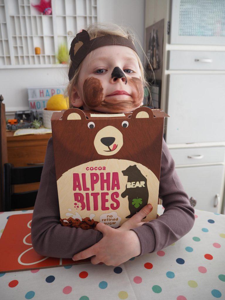 girl hugging a box of BEAR Alphabites