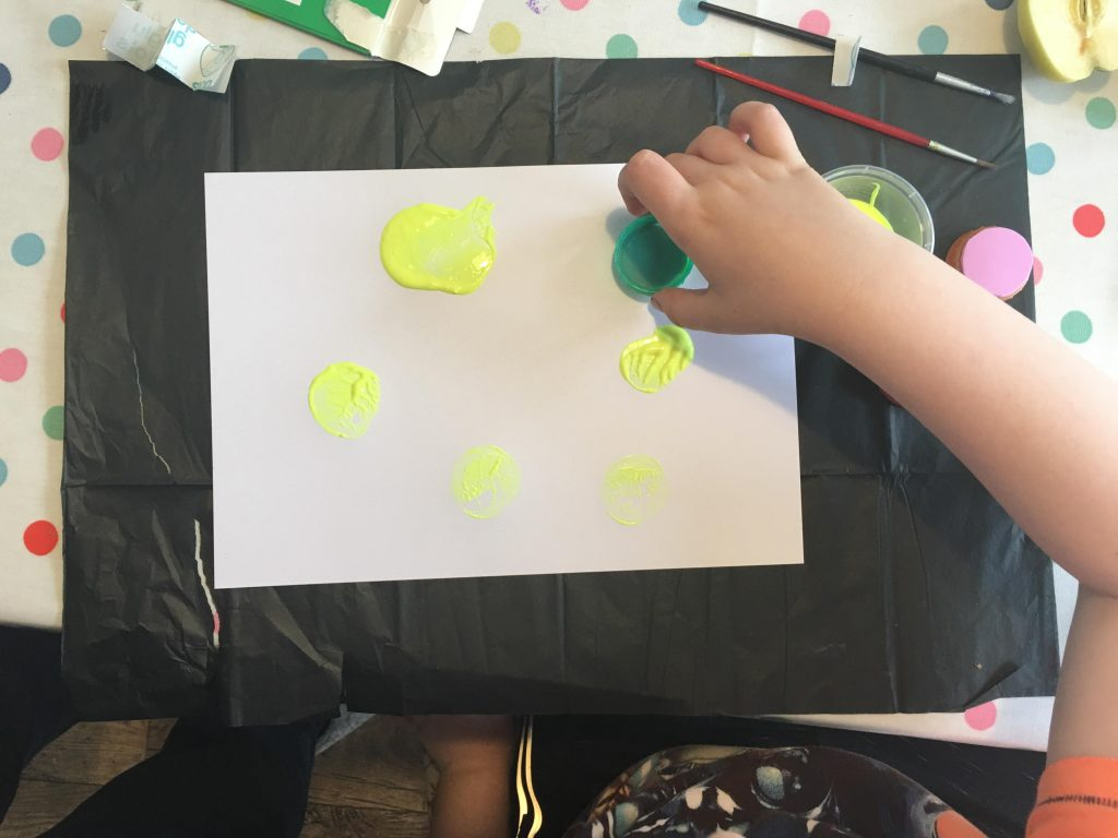 making Bottle top stamps with kids