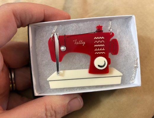 Tatty Devine acrylic sewing machine necklace