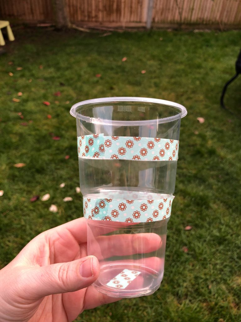 washi tape around a plastic cup
