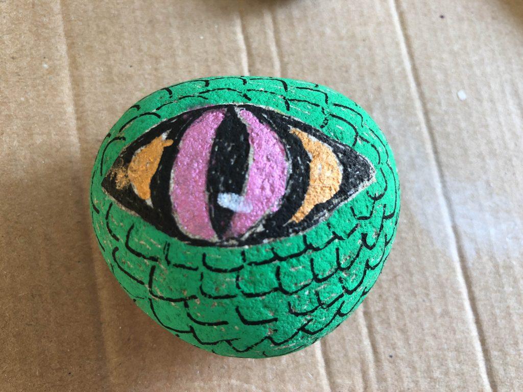 Dinosaur eye painted rock