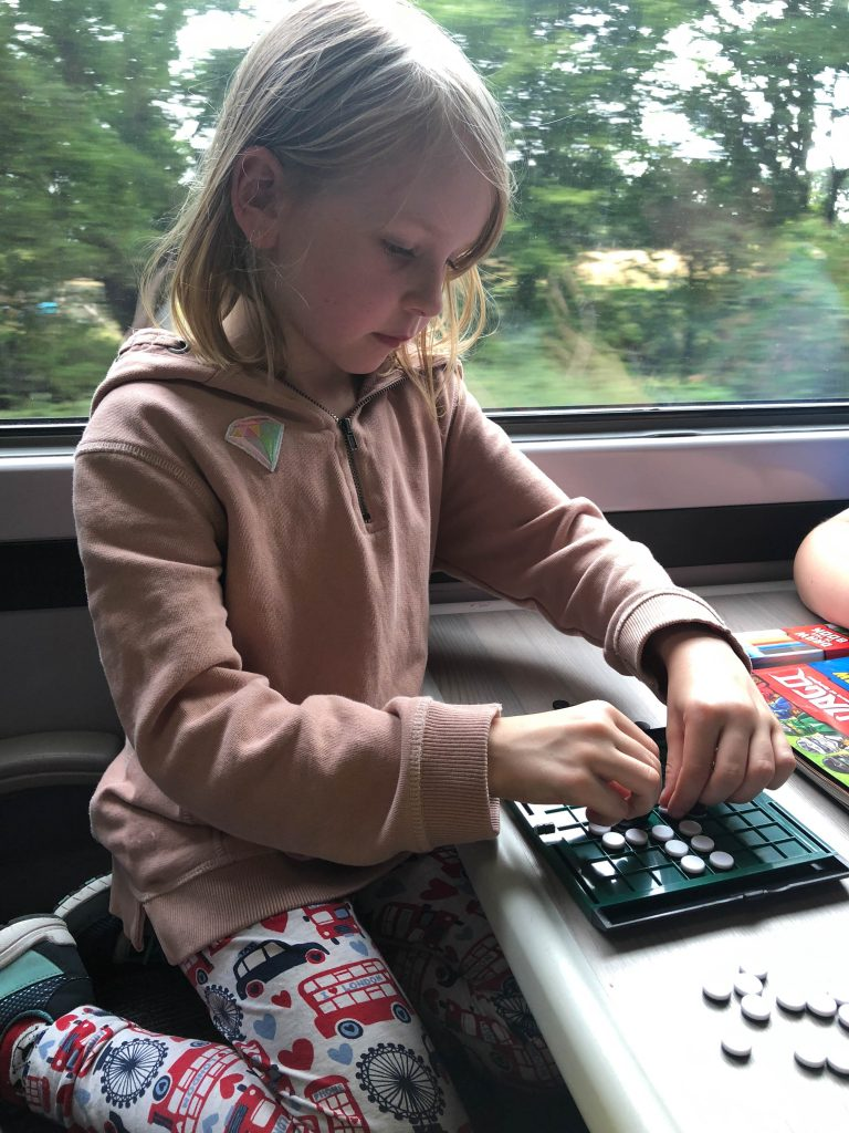 playing travel games on the train