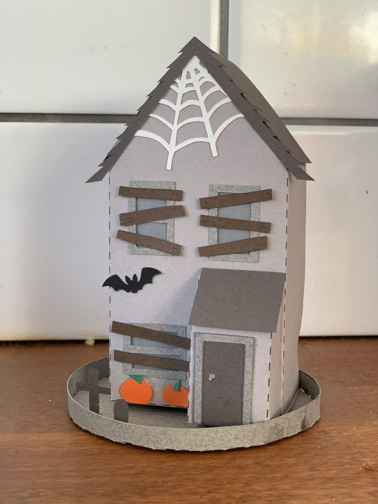 making a spooky papercut house for Halloween