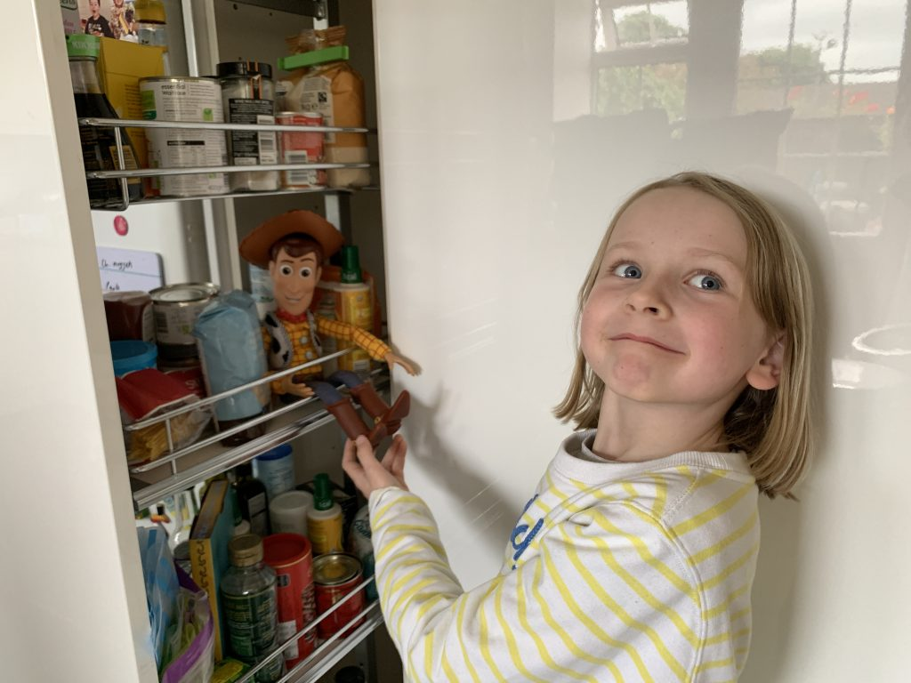 discovering Woody in the kitchen