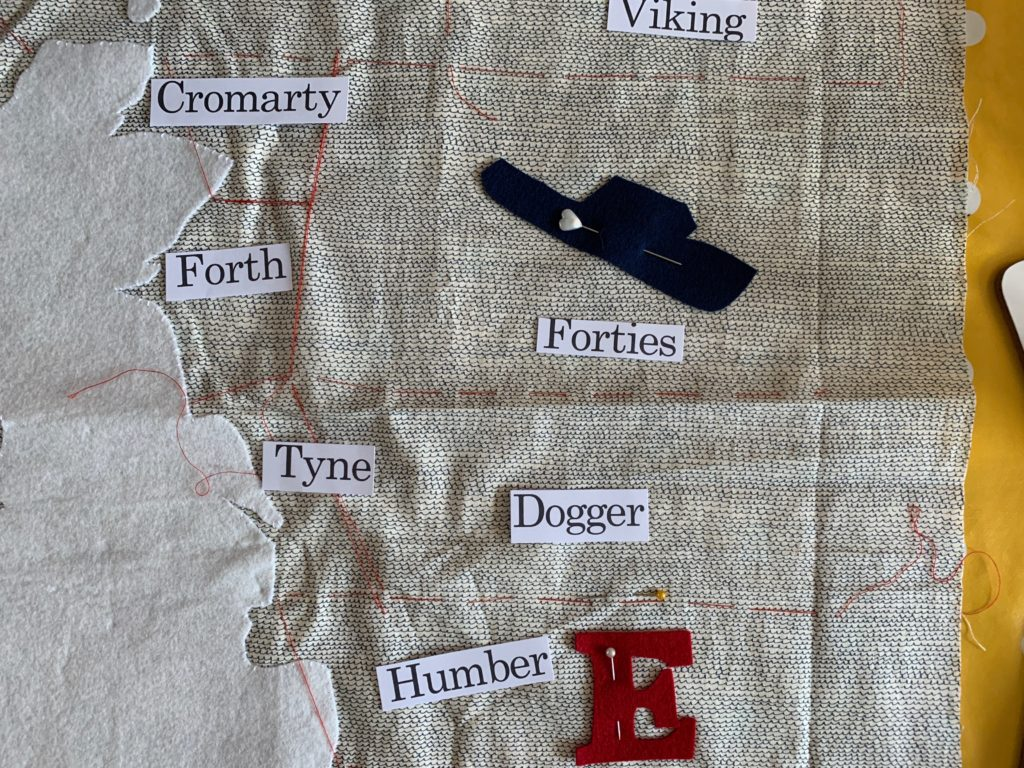 paper labels on a quilt top