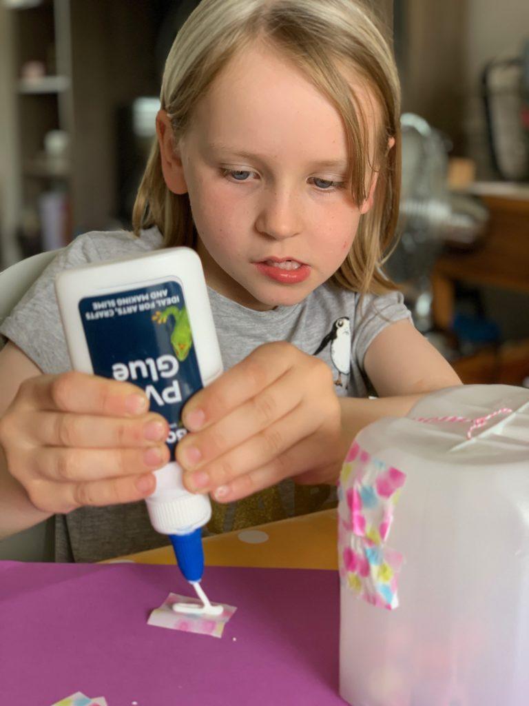 child squeezing glue