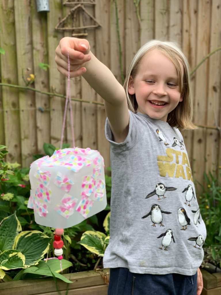girl holding a craft project