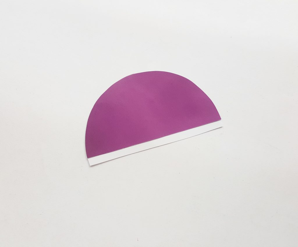 purple semicircle of paper