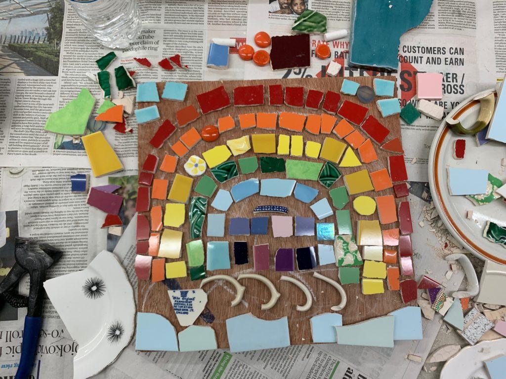 cutting tiles for a rainbow mosaic