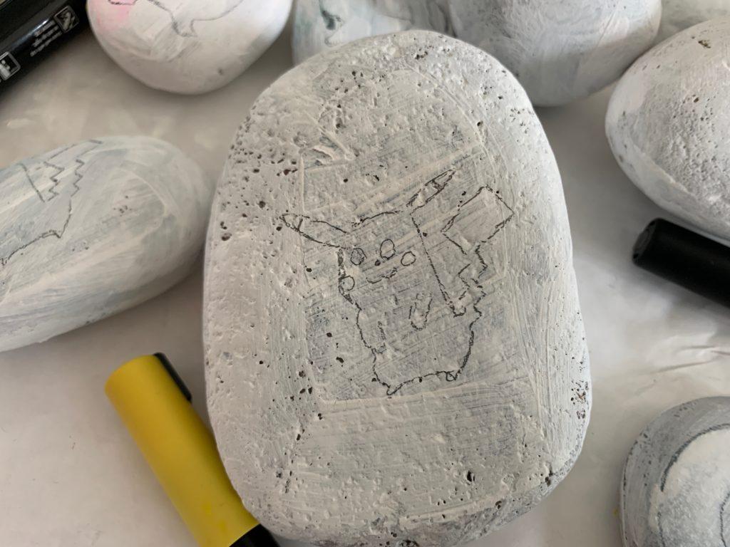 drawing pikachu on a rock
