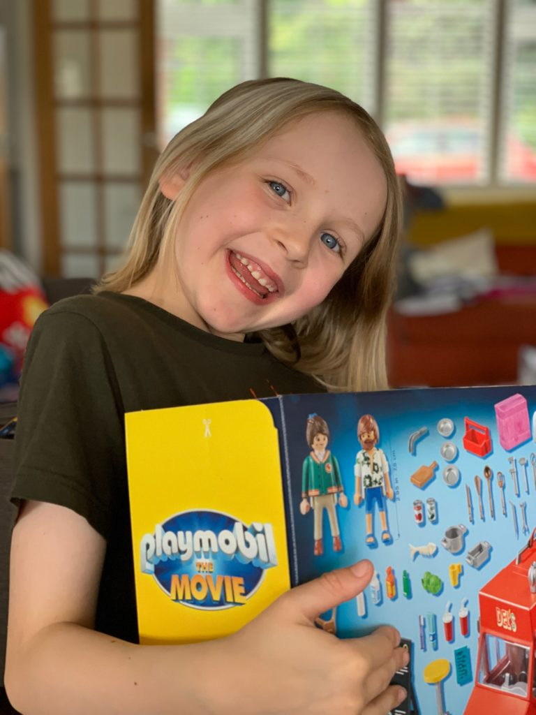girl with Playmobil toy box