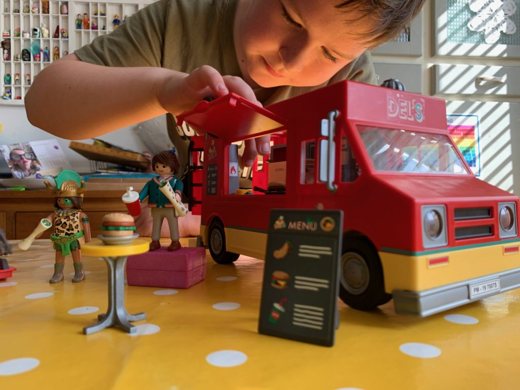 boy playing with Playmobil toy