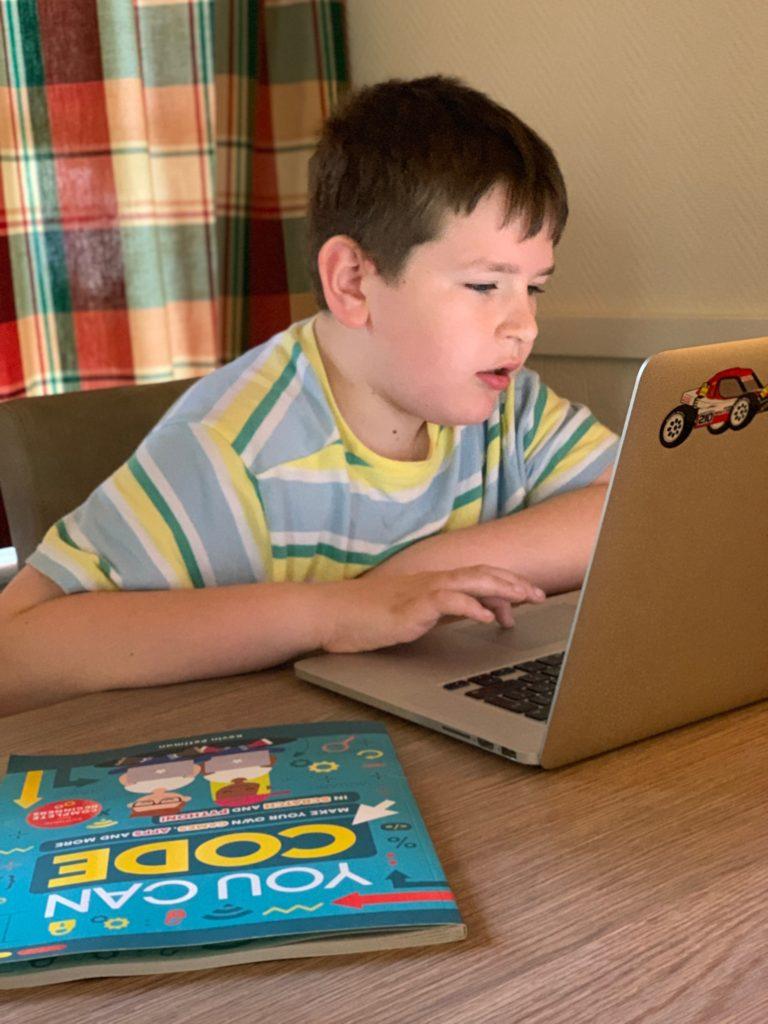 boy playing at a laptop