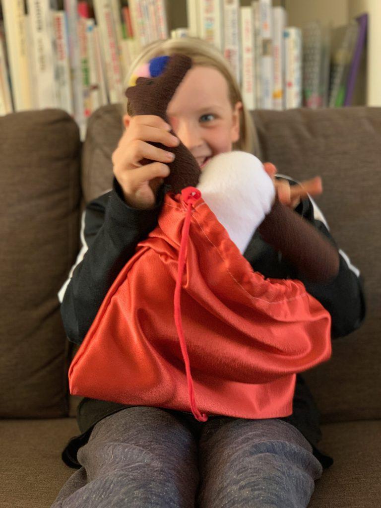 girl opening bag