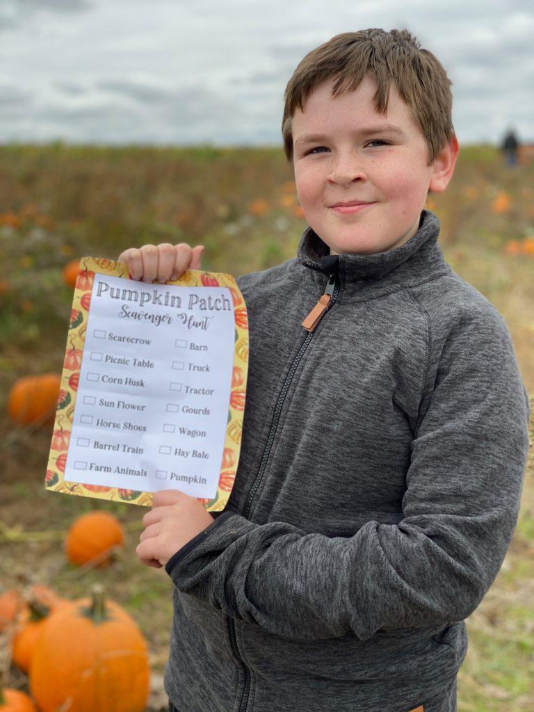 boy holding a printable