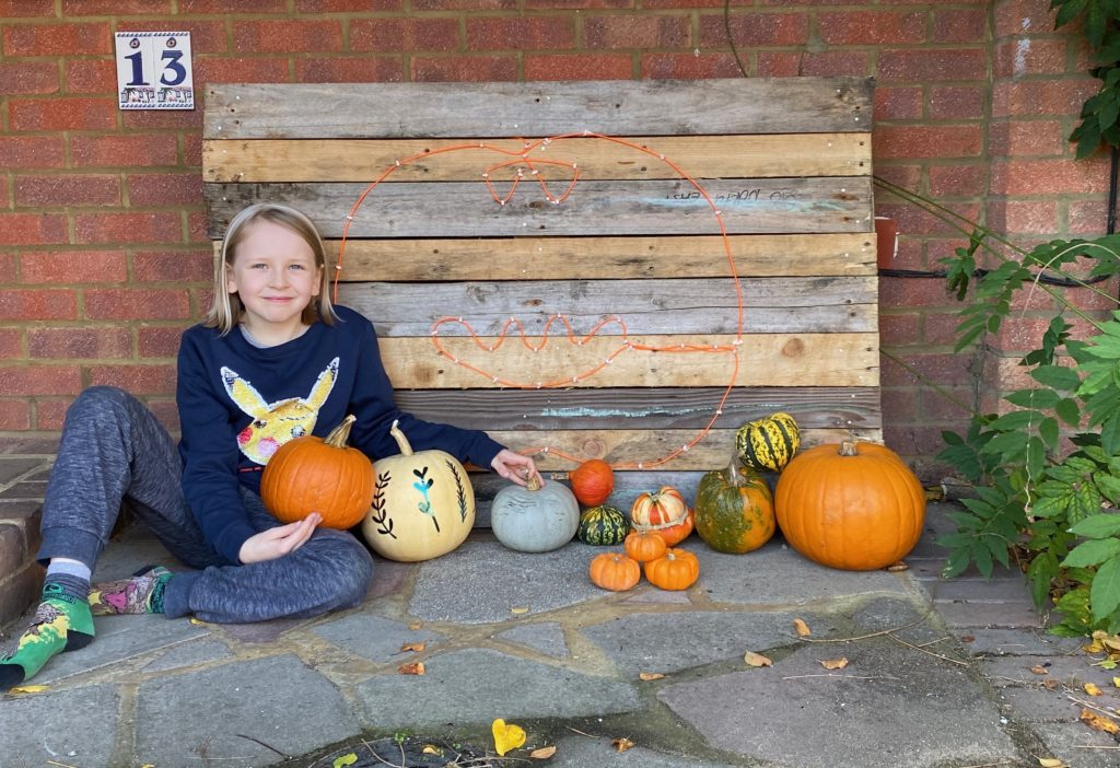 glow in the dark Halloween pumpkin sign