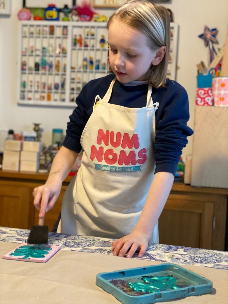 child making diy wrapping paper