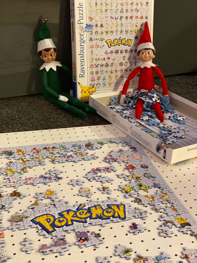 Elf on the Shelf doing a jigsaw