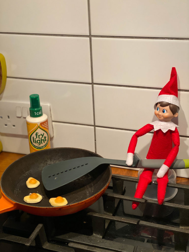 Elf on the Shelf frying candy eggs