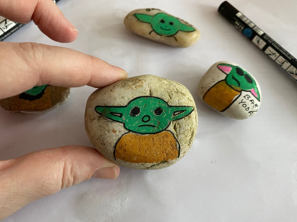Top 50 Star Wars Crafts, Activities, Workbooks, Worksheets to entertain your family, featured by top US Disney Blogger, Marcie and the Mouse: Easy Baby Yoda painted rocks