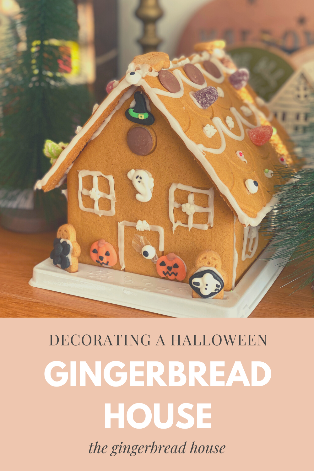 Decorating a gingerbread house for Halloween